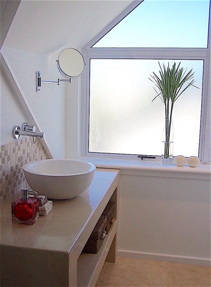 Guest bathroom with slanted ceiling