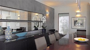 Accent wall with large horizontal mirrors in dining room remodel