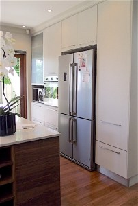 Tall cabinets with eye-height ovens in kitchen remodel