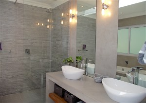 Large walk-in shower with full-height glass panels in contemporary bathroom remodel