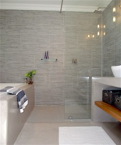 Master bathroom with walk-in shower with full-height glass panel