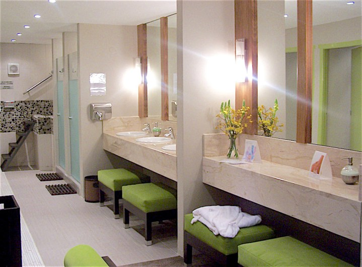 Contemporary commercial bathroom and restroom with green ottomans