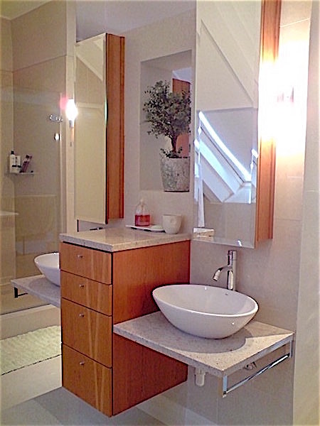 Double vanity with floating storage and tall mirrors