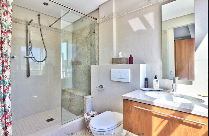 Bathroom with walk-in shower and frameless glass