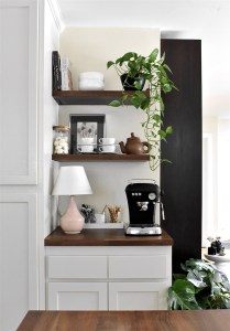Coffee nook with open shelves and pink table lamp