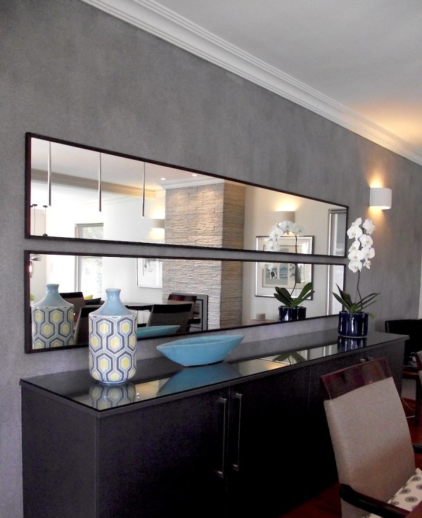 Feature wall with two large mirrors installed horizontally