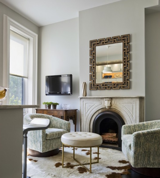 TV above antique server next to fireplace in cute setting