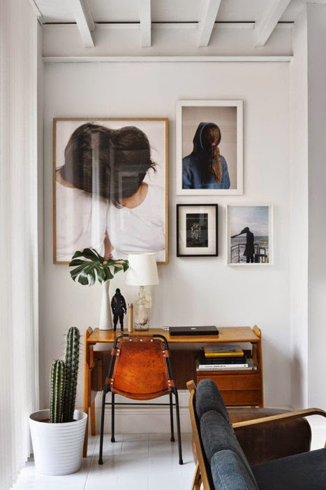 Home office with leather chair and gallery art