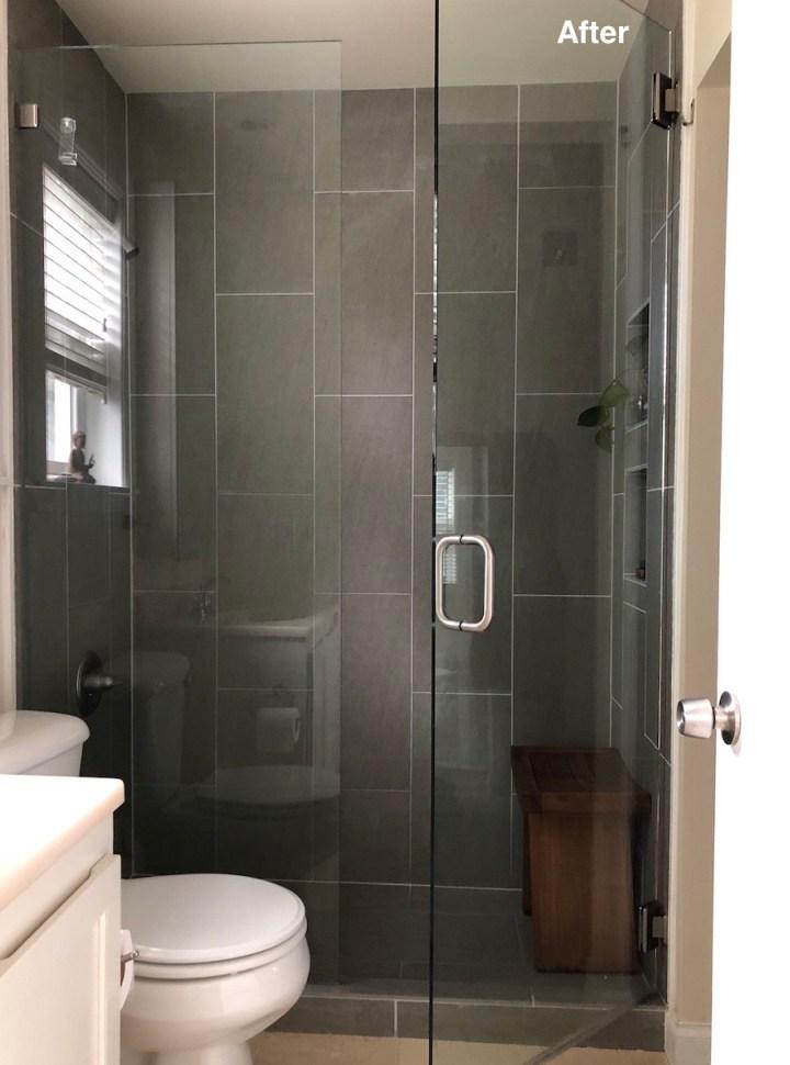 Bathroom with frameless glass door