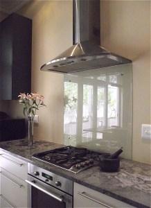 Contemporary kitchen remodel with glass backsplash