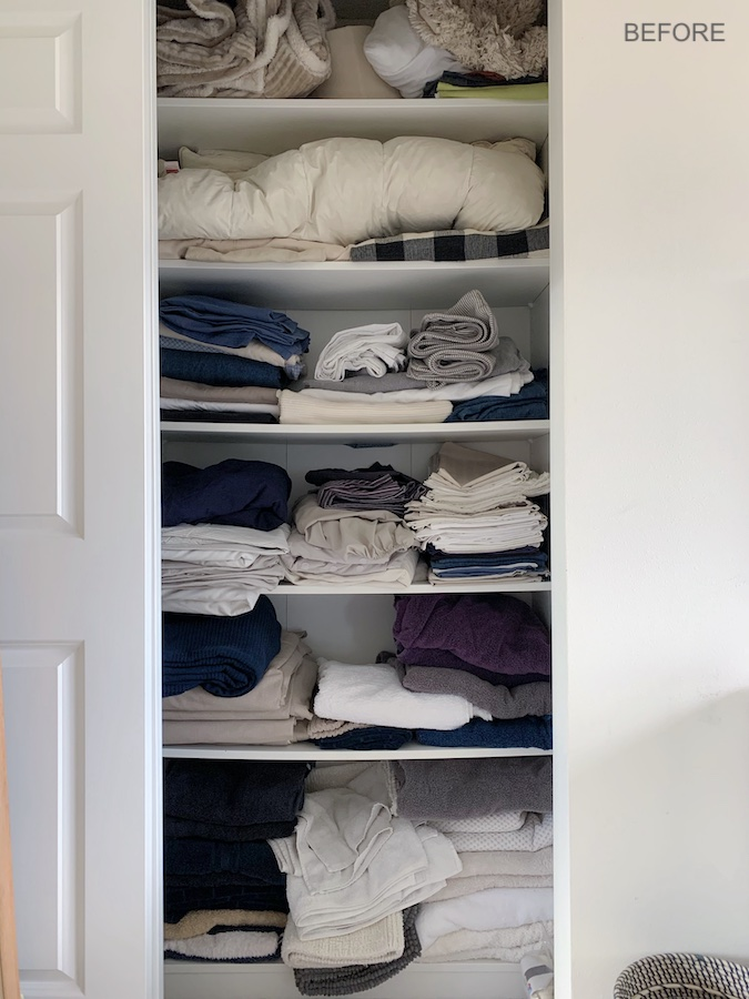 Linen closet before decluttering and organizing