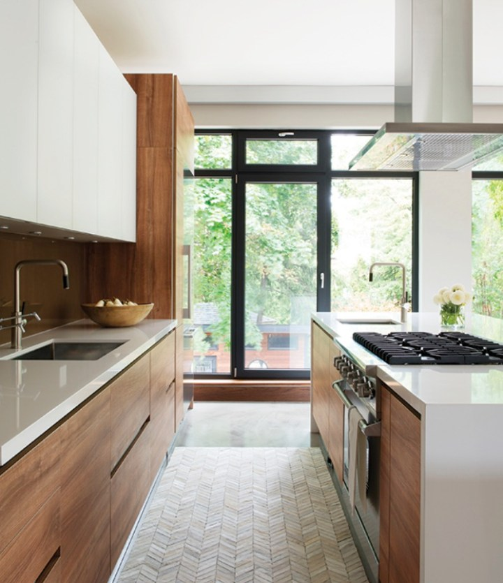 Warm-contemporary-kitchen-island-with-range-and-sink-in-warm-walnut-wood-and-white-quartz-large-open-window