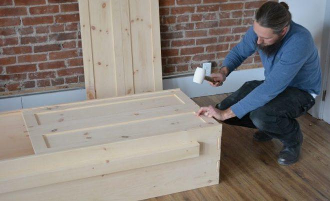 Local Woodworker constructing casket