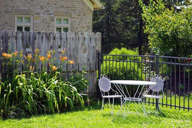 Backyard with picket fence and table