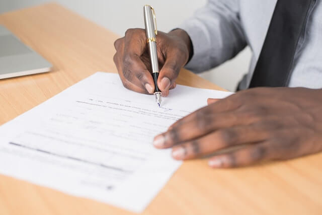 Close-up of someone signing a contract