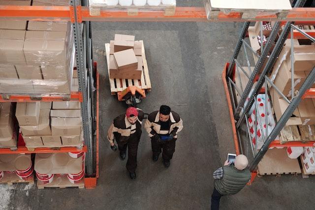 Two men walking side by side in a warehouse