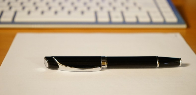Pen With Keyboard in Background