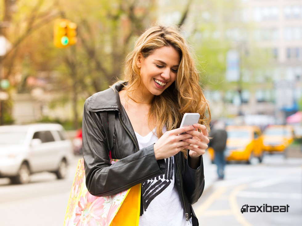 Taxibeat-girl-with-phone
