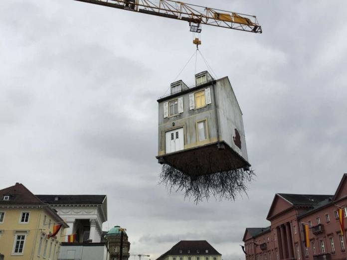 Leandro Erlich,Pulled by the Roots, 2015. Photo: Market Place Karlsruhe, Germany