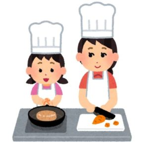一緒に料理をする親子