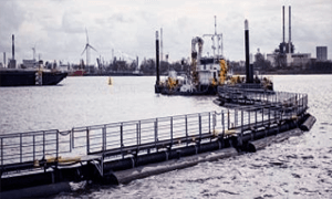 DREDGING TO REMOVE HEAVILY POLLUTED SLUDGE AT PORT OF ANTWERP