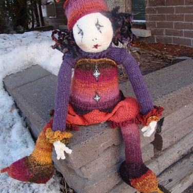 http://www.ravelry.com/patterns/library/the-harlequins-outfit