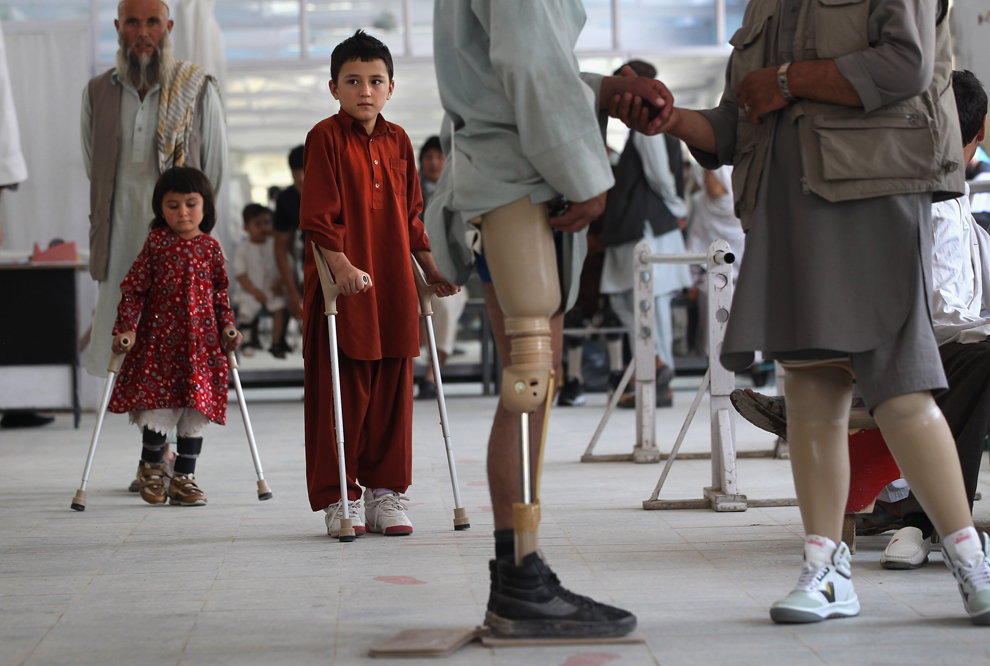 Afghan war amputees and children practice walking at the International Committee of the Red Cross orthopedic center on Sept. 10 in Kabul