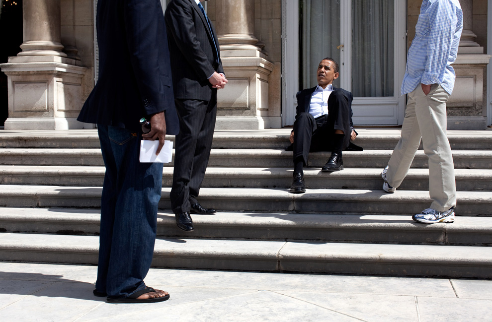 President Obama talks with aides outside the U.S. Ambassadors residence in Paris