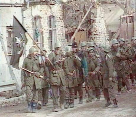 "Vukovar, Croatia 1991 Serb Chetnik and Serb-led Yugoslav army march into Vukovar singing: ""Slobo, Slobo (as in Slobodan Milosevic) send us some salad, there will be meat, we'll slaughter the Croats"" (BBC newsreel screenshot)"