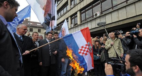 Vicious and Indicted Serb War Criminal  Vojislav Seselj Burns the Croatian Flag in Belgrade