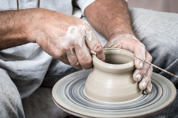 Photo of a potter at work
