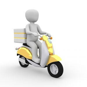 Incapacidad permanente total por espondilitis a un cartero con moto.