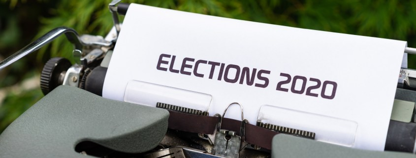 The image highlights an old typewriter with a sheet: elections 2020