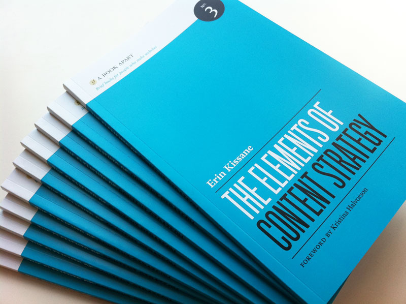 A picture of a stack of bookd titled The Elements of Content Strategy