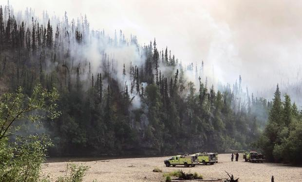 Smoke and fire backing down the ridge to the cliffs above the Chena River.