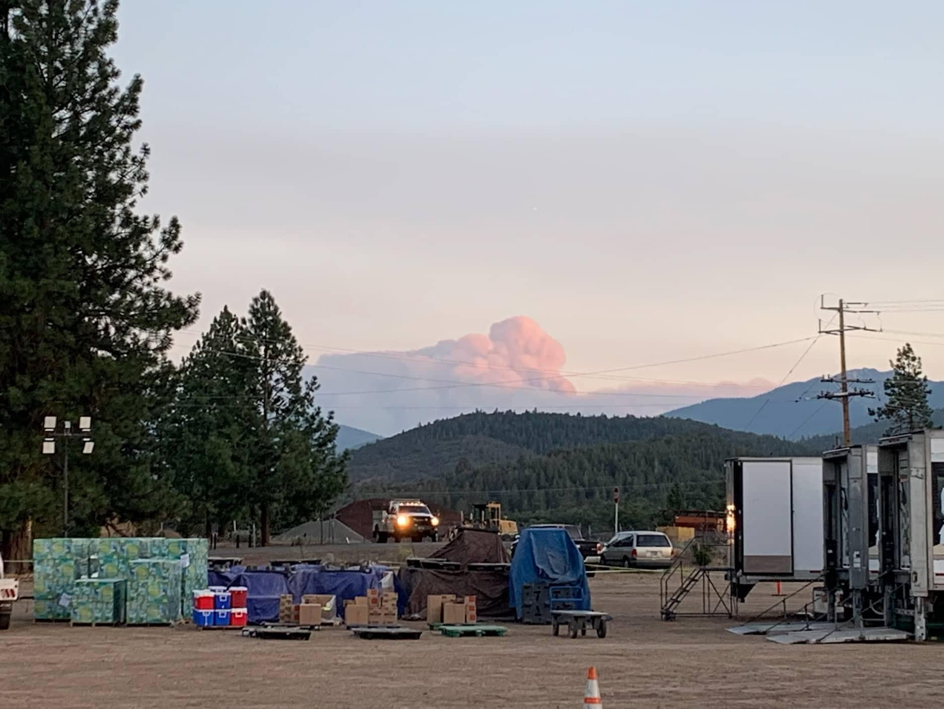 A large plume of smoke from the Haypress Fire is visible west of the town of Etna, CA