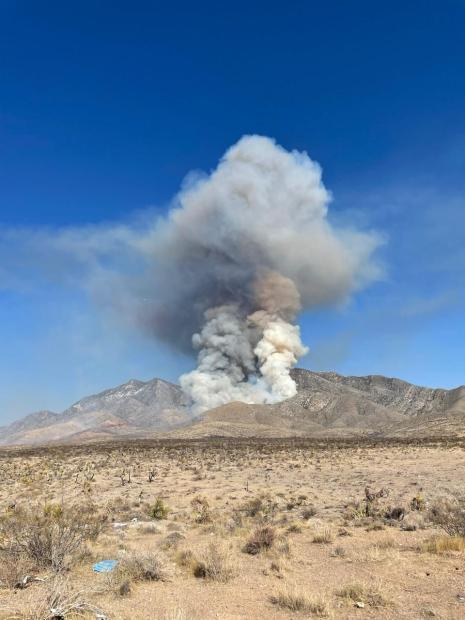 Smoke column rising in mountains from Sandy Valley Fire