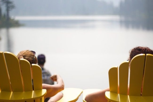 Relaxing in chairs by lake