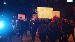 U of I students march on campus in honor of Michael Brown