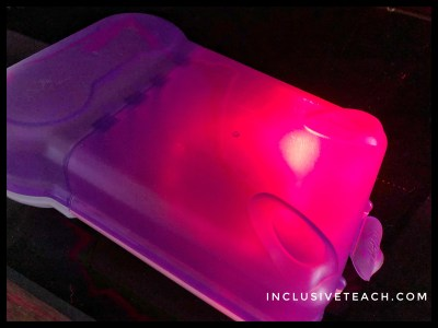 Light in a tupperware container sensory learning idea.