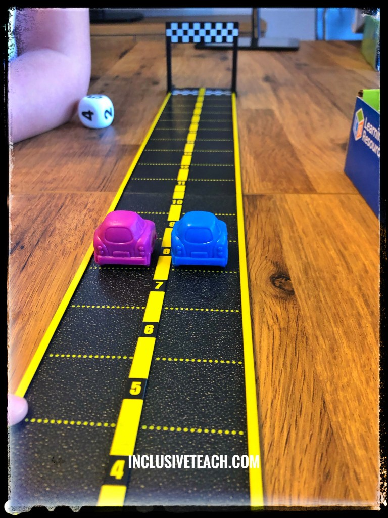 Mini motor maths game SEND learners inclusive numeracy activities one blue car and one purple car