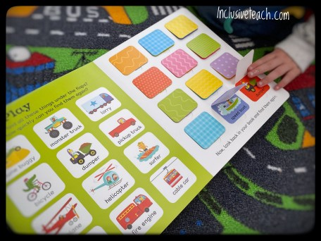 Lift the flap children's vehicle book for eyfs. Child's hand opening flap
