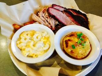 Chopped pork, brisket, mac and cheese, and seasonal sides at Luella's BBQ