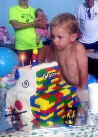 #323- Mason is amazed by his Lego cake