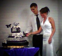 #78-Mr. and Mrs. Titus share their wedding cake.
