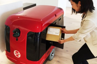 Petit Routemaster delivers mail in office (Tokyo, JAPAN)