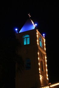 The bell tower lit up and ready for Mass.