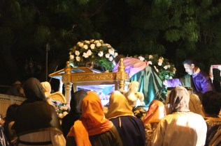 The Jesus effigy being placed in the casket.