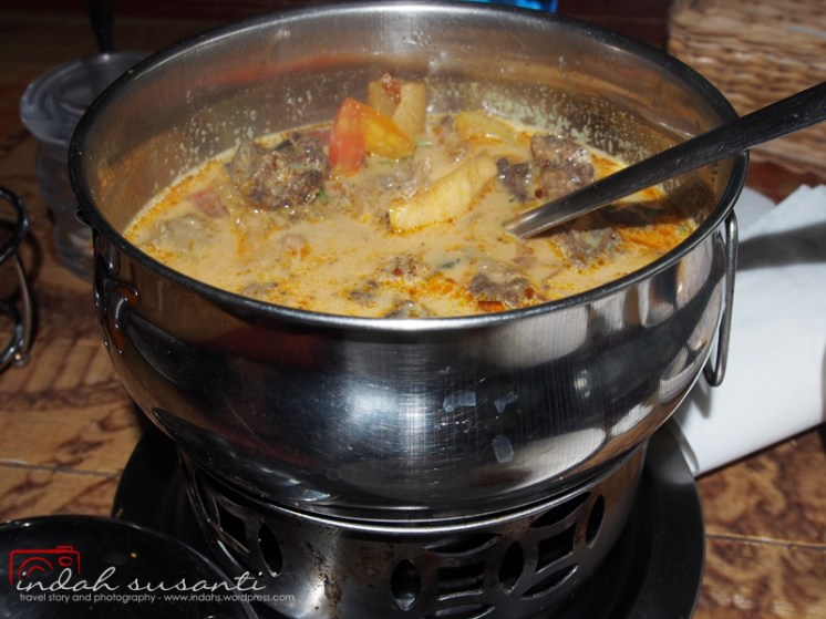 Soto Betawi served in warm pot