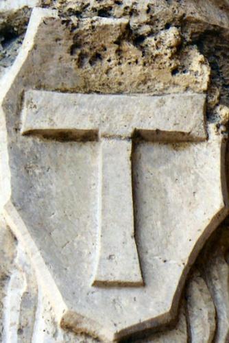 Tau cross in stone